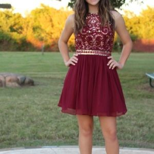 A maroon dress that was only worn once.